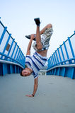 Breakdancer on bridge Royalty Free Stock Image