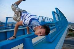 Breakdancer on bridge Royalty Free Stock Photos