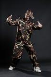 Breakdancer in camouflage. Over dark background stock images