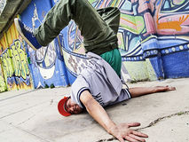 Breakdancer in a dancing pose. Portrait of a dancing breakdancer at street Stock Photos
