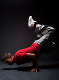 Breakdancer in freeze. Against dark background royalty free stock images
