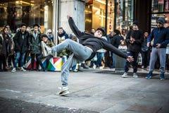 Breakdancer guys in Milan dancing in the street. MILAN, ITALY - DECEMBER 14: breakdancers in downtown Milan on December, 14 2013: a group of performer guys Royalty Free Stock Photos