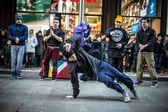 Breakdancer guys in Milan dancing in the street. MILAN, ITALY - DECEMBER 14: breakdancers in downtown Milan on December, 14 2013: a group of performer guys Royalty Free Stock Photo