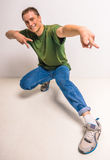 Breakdancer. Handsome breakdancer standing at studio on white background Stock Photography
