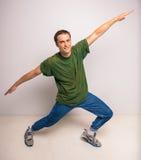 Breakdancer. Handsome breakdancer standing at studio on white background Royalty Free Stock Photo