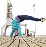 Breakdancer handstanding and jumping Stock Images