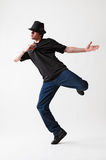 Breakdancer in hat. Posing against white background Royalty Free Stock Images