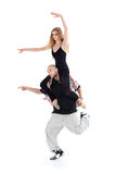 Breakdancer keeps on shoulders ballerina Royalty Free Stock Image