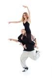 Breakdancer keeps on shoulders ballerina Royalty Free Stock Image