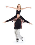 Breakdancer keeps on shoulders ballerina and poses. On white background Stock Images