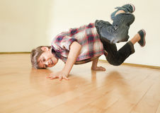 Breakdancer. Little boy standing on both hands. Body almost horizontal stock images