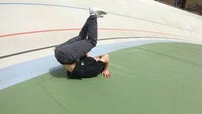 Breakdancer man make flips on a stadium. Breakdancer man make a flips on the stadium stock footage