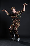 Breakdancer in military uniform. Over black background stock photography