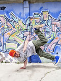 Breakdancer moving. Portrait of a dancing breakdancer at street royalty free stock photo