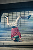 Breakdancer performer doing head stand Royalty Free Stock Image