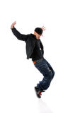 Breakdancer Performing. African American breakdancer performing isolated over white background stock photography