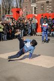 Breakdancer performing in Museumplein in Amsterdam Netherlands. March, 2015. Portrait format stock images