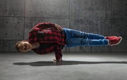 Breakdancer posing in studio. Young stylish male breakdancer posing in studio Royalty Free Stock Image