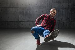 Breakdancer posing in studio. Young stylish male breakdancer posing in studio stock photography