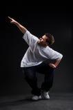 Breakdancer que señala en algo Foto de archivo