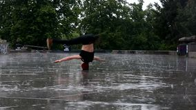 Breakdancer in the rain in Prague