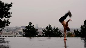 Breakdancer in the rain in Prague stock video footage