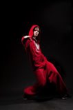 Breakdancer in red suit Stock Image