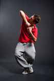 Breakdancer in red t-shirt. Posing against dark background royalty free stock images