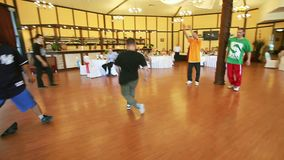 Breakdancer shows his breakdance skill on a dance floor stock video footage