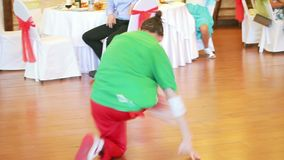 Breakdancer shows his breakdance skill on a dance floor stock footage