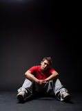 Breakdancer sitting on the floor Stock Photography