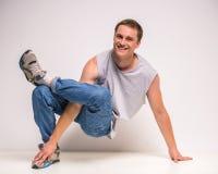 Breakdancer. Skilful breakdancer posing at studio on white background Royalty Free Stock Image