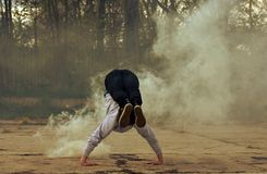 Breakdancer in smoke on the street Stock Photography