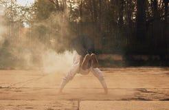 Breakdancer in smoke on the street Stock Photo