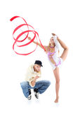 Breakdancer squats and gymnast girl with ribbon stands Royalty Free Stock Photo