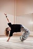 Breakdancer standing in bridge. Photo in dance studio stock images