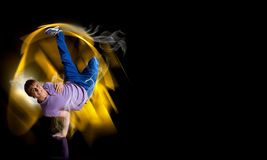 Breakdancer standing on hand Stock Photo