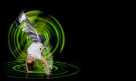 Breakdancer standing on hand Royalty Free Stock Images