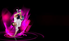 Breakdancer standing on hand Royalty Free Stock Photos