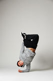 Breakdancer standing on his elbow Royalty Free Stock Photo