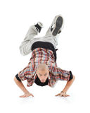 Breakdancer stands on hands and looks at camera Stock Photos