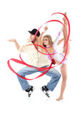 Breakdancer stands on tiptoe in profile and gymnast girl witn ribbon Royalty Free Stock Images