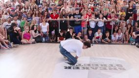 Breakdancer at Street fight festival on street stage during Day of Russia holiday. PERM, RUSSIA - JUN 12, 2016: Breakdancer at Street fight festival on street stock video footage