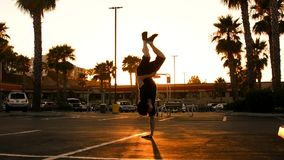 Breakdancer on the street in the sunset stock video