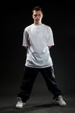 Breakdancer in white t-shirt. Standing against white background royalty free stock image