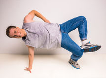 Breakdancer. Young and beautiful breakdancer posing at studio on white background Stock Photography