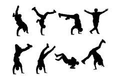 breakdancers剪影  节律唱诵的音乐男性舞蹈家导航在白色背景隔绝的剪影 免版税库存照片