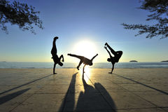 Breakdancers in action. Breakdancers performing their dance with silhouette effect Stock Photo