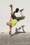 Breakdancing. Young hip hop dancer breakdancing outdoors Royalty Free Stock Image