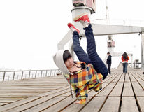 Breakdancing. Young female breakdancing and handstanding Royalty Free Stock Photography